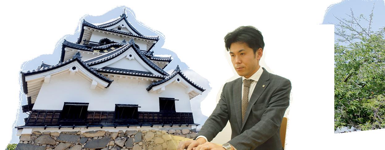 彦根城と職員の画像